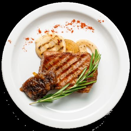 Стейк зі свинини під соусом агродольче і цибулею гриль